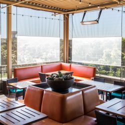 motorized patio screens sun shade material clear vinyl windows rooftop patio del frisco restaurant orange furniture