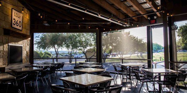 restaurant motorized sun shades lowered jack allens patio austin texas