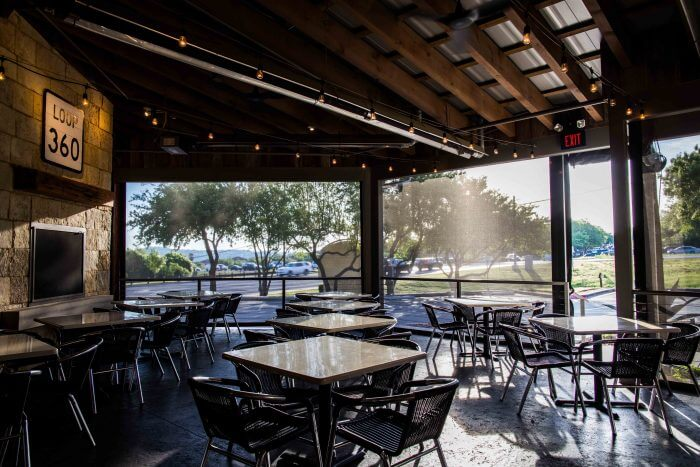restaurant motorized sun shades lowered jack allens patio austin texas