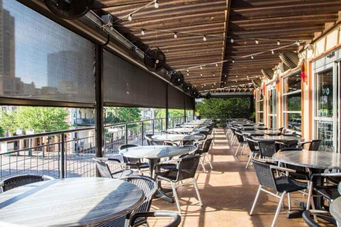 retractable sun shades restaurant patio iron cactus austin tx