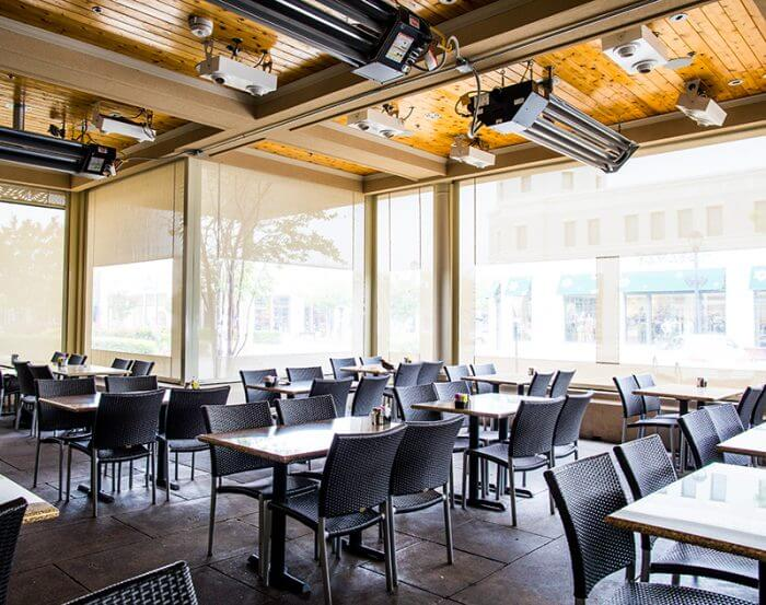 custom beige patio sun shades with clear vinyl windows and climate control system deployed glorias interior patio garland texas restaurant furniture