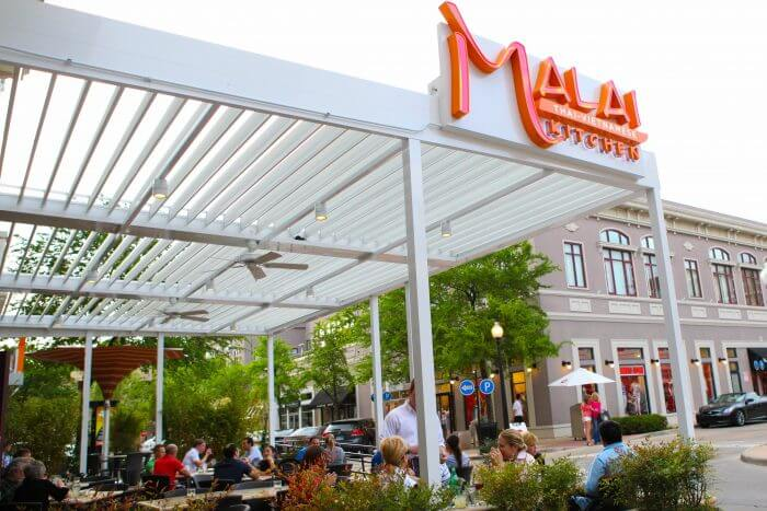 commercial louvered roof malai kitchen restaurant patio white structure outdoors daylight