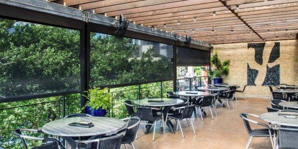 iron cactus shaded patio motorized restaurant solar shades